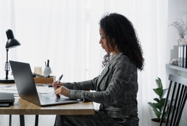 payroll worker at desk