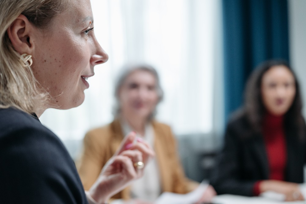 Psychologist speaking to colleagues at group psychotherapy practice