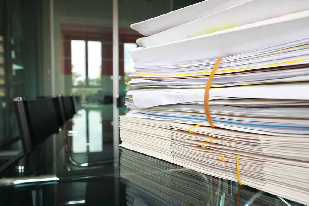 stack of clinical reports