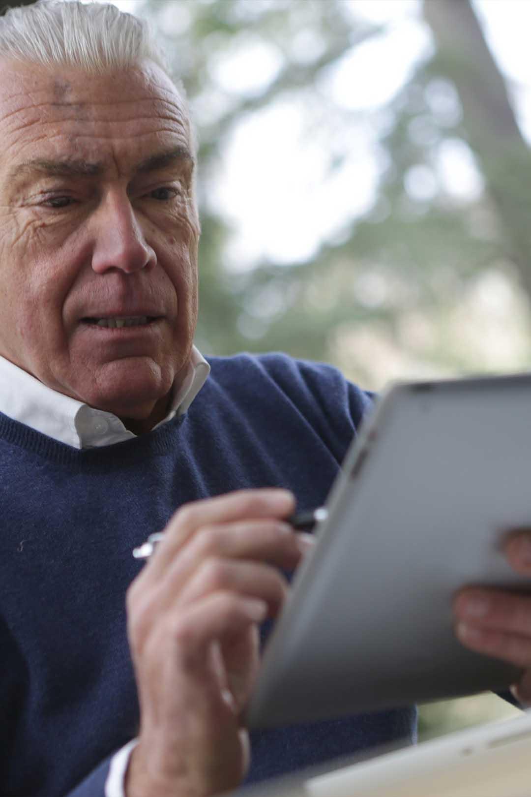 man eSigning on tablet