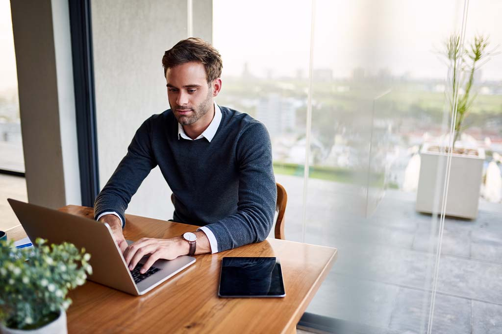 man working on laptop