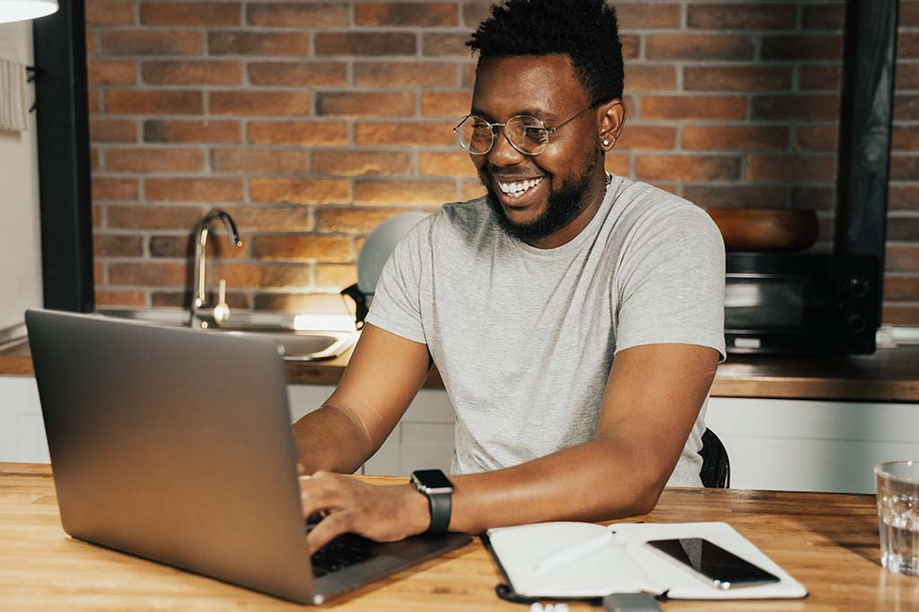 man scheduling appointment on laptop