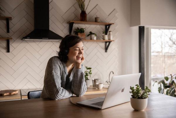 woman using telehealth on laptop